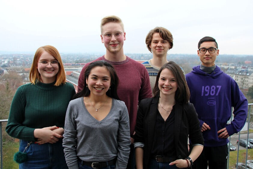 Group photo of student employees on roof terrace